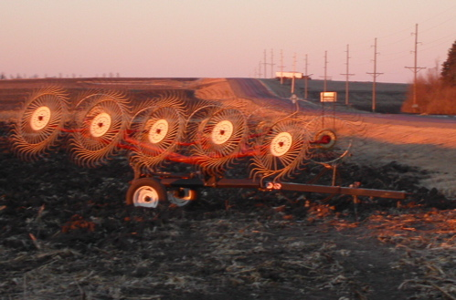 Farm machinery glowing in the sunset