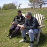 Peter and John seated on the prairie